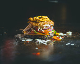 burger patty flamed on grill